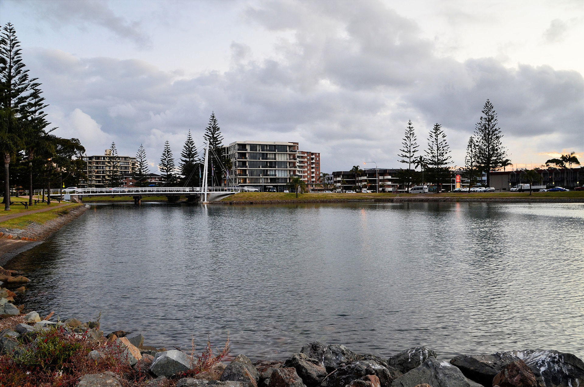horizontal view of Port Macquarie, featuring a landscape of a lake